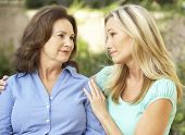 Senior Woman Being Consoled By Adult Daughter