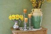 stock photo of flower vase  - designer display of flowers vases and candles inside a home - JPG