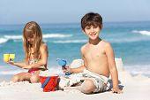 Children Building Sandcastles On Beach Holiday