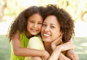 stock photo of mother daughter  - Portrait Of Mother And Daughter In Park - JPG