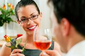 Young couple having romantic dinner �¢�?�? he is drinking rose wine