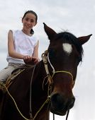 stock photo of horse riding  - teenage girl on a horse - JPG