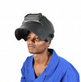 pic of blue-collar-worker  - African man wearing welding helmet and blue overall isolated on a white background - JPG