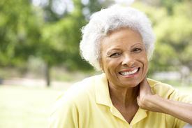 image of african american woman  - Portrait Of Smiling Senior Woman Outdoors - JPG