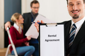 foto of real-estate agent  - Young couple renting a home or apartment - JPG