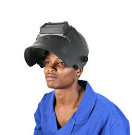 picture of blue-collar-worker  - African man wearing welding helmet and blue overall isolated on a white background - JPG