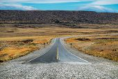 End of the asphalt road named Ruta 40 in Argentinian Patagonia. Asphalt road turns into gravel road  poster