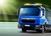 stock photo of towing  - New blue breakdown vehicle with yellow signal lights - JPG