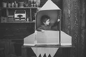 Kid Sit In Cardboard Hand Made Rocket. Childhood Concept. Boy Play At Home With Rocket, Little Cosmo poster