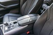 Modern Luxury Car Inside. Interior Of Prestige Modern Car. Comfortable Leather Seats. Black Perforat poster