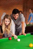 stock photo of snooker  - Portrait of a couple playing snooker in a student home - JPG