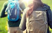 travel, hiking, backpacking, tourism and people concept - close up of couple with backpacks walking  poster