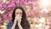 Woman Blowing Nose Because Of Spring Pollen Allergy poster