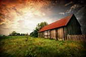 Sunset By An Old Barn
