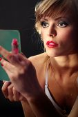 Beautiful Young Woman Looking In Hand Mirror