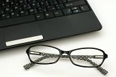 Business Glasses Near A Laptop Keyboard