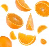 flying sliced orange fruit segments   isolated on white background