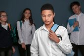 Teens bullying their African American classmate indoors poster