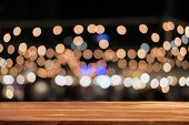 Empty Wooden Table In Front Of Abstract Blurred Background Of Bokeh . Can Be Used For Display Or Mon poster