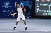BUKIT JALIL, MALAYSIA- OCT 01: Japan's Kei Nishikori hits a forehand return in this Malaysian Open s