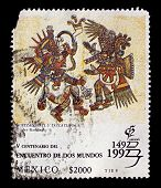 MEXICO-CIRCA 1992:A stamp printed in Mexico shows image of Quetzalcoatl und Tezcatlipoca illustratio