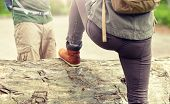 adventure, travel, tourism, hike and people concept - close up of couple with backpacks walking and  poster