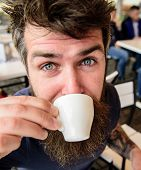 Guy Having Rest With Espresso Coffee. Coffee Break Concept. Hipster On Calm Face Drinking Coffee Out poster