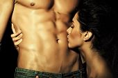 Closeup Of Undressed Sensual Pair Of Young Brunette Lady Embracing And Kissing Man With Beautiful Mu poster