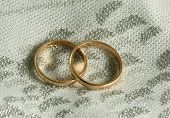 Two Golden Rings On A Piece Of A Wedding Dress