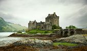 stock photo of fortified wall  - Eilean Donan castle on a cloudy day - JPG