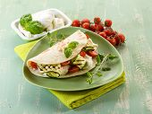 piadina with mozzarella, grelled zucchinis and tomatoes,  typical italian sandwich