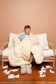 picture of housecoat  - This image shows a sick man on the couch - JPG