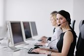 business people group with  headphones giving support in  help desk office to customers, manager giv