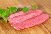 Veal Steak , raw with herbs and peppercorn