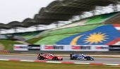 SEPANG - JUNE 9: A Honda HSV-010 (17) leads the Nissan GTR (23) during practice at the 2012 Autobacs