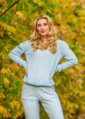 Sporty Girl. Girl Relaxing In Nature Wearing Knitwear Suit. Clothes For Rest. Feel Practicality And  poster