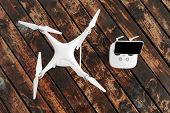Drone quadcopter on the old wooden background poster