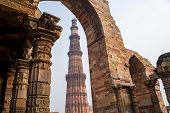 Qutub Minar Pillar Framed By An Arch At At The Historic Site In New Delhi India poster