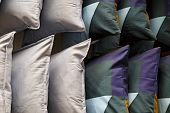 Green, White, Pink Square Pillows Are Shot Close-up. Colorful Background Of Soft Pillows. poster