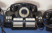 Black Antique Telephone. Vintage Old Telephone On Desk poster