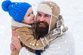 Daddy And Boy Smiling And Hugging. Happy Family Son Hugs His Dad On Winter Holiday poster
