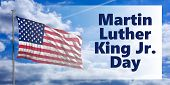Martin Luther King Jr Day Text And Usa Flag Waving Against Blue Sky Background. Mlk Day Us National  poster