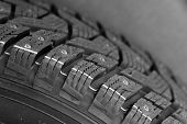Close-up Side View Of A Fragment Of A Car Studded Tire. Automotive Industry Concept. The Concept Of  poster