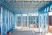 stock photo of stud  - New home under construction using steel frames - JPG