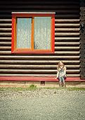 foto of post-teen  - girl teen is sitting near wood house - JPG