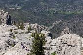 The View From Black Elk Peak, Formerly Called Harney Peak, With Visitors Sitting On Quartz Rock Form poster
