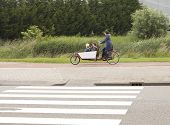 Biking The Children To School In The Netherlands