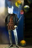 Fashion Store. Dummy In A Clothing Store Male Mannequin In A Mask, Jeans, Shirt And Jacket. The Show poster