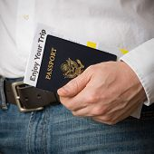 American Passport With Documents In The Hand Of A Man. Passport, Plane Tickets And Car Rental Docume poster
