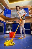 Cleaner in the kitchen at home